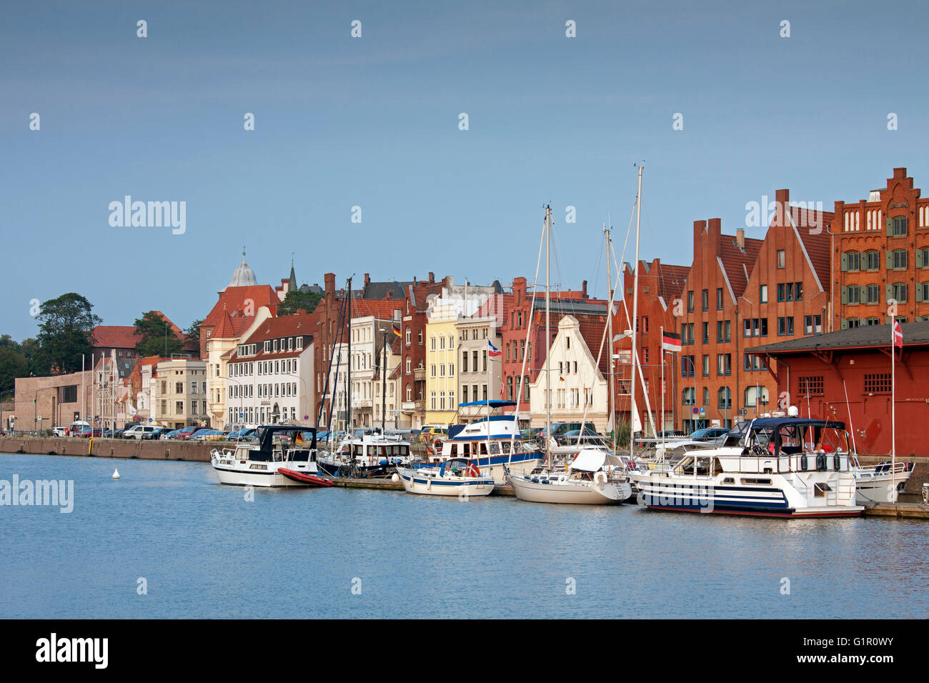 Historic houses along the river Trave, Hanseatic town Lübeck, Schleswig-Holstein, Germany - Stock Image