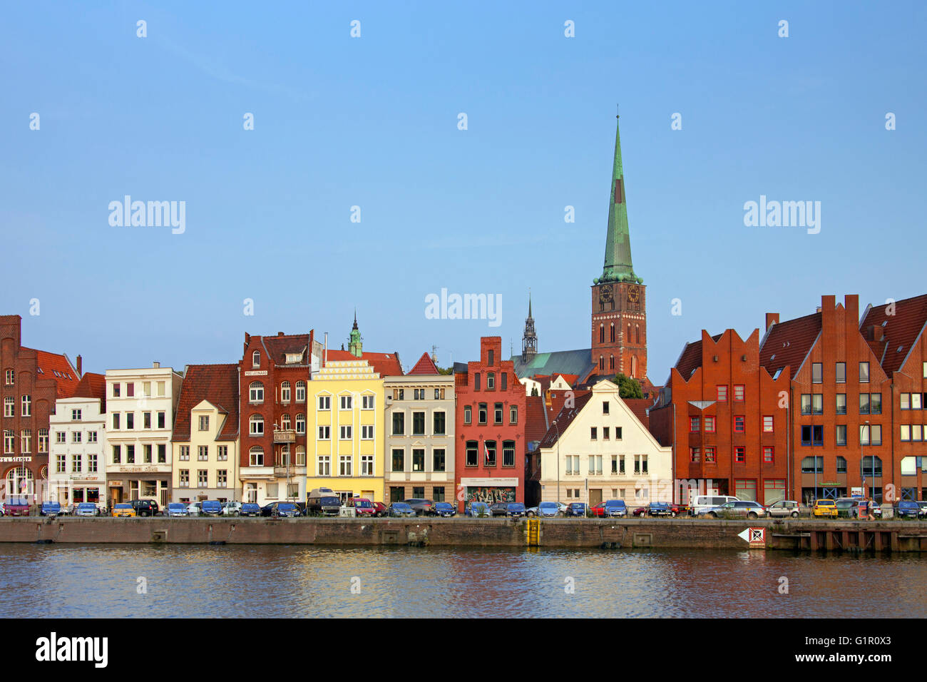 Historic houses and Jakobikirche / St. Jakobi church along the river Trave, Hanseatic town Lübeck, Schleswig - Stock Image