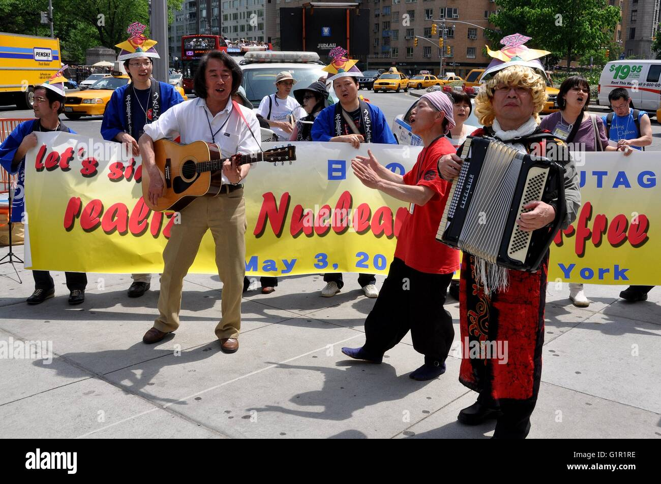 New York City:   Japanese musicians from UTAGOE singing at Columbus Circle during a demonstration for a nuclear - Stock Image