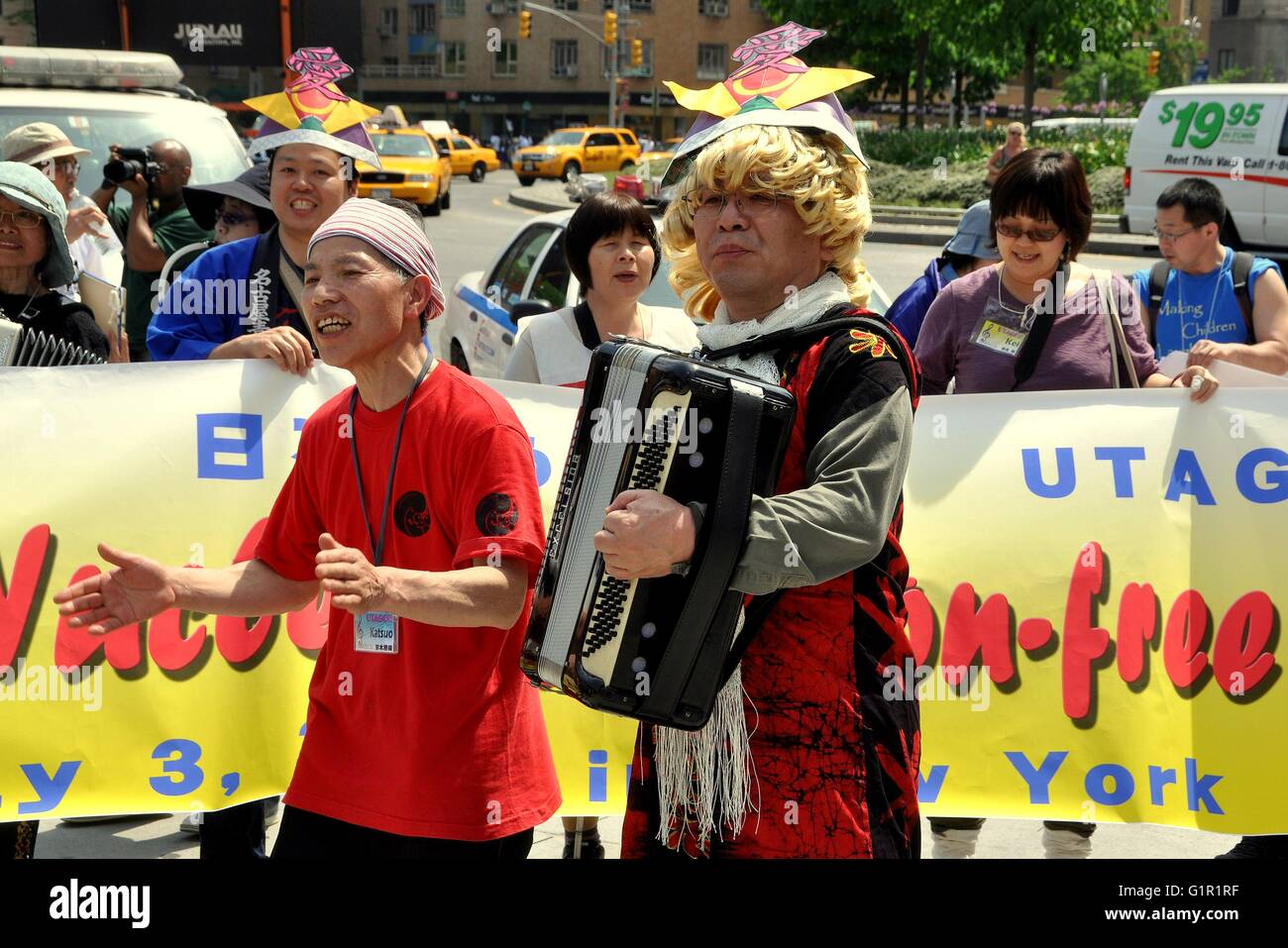 New York City   Japanese musicians from UTAGOE singing at Columbus Circle during a demonstration for a nuclear free - Stock Image