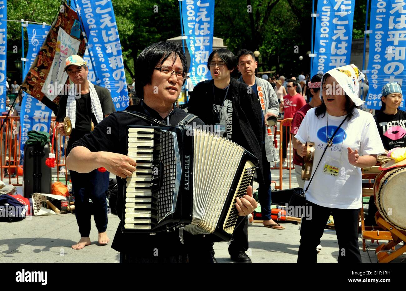 New York City:    Japanese musicians afrom UTAGOE singing at Columbus Circle during a demonstration for a nuclear - Stock Image