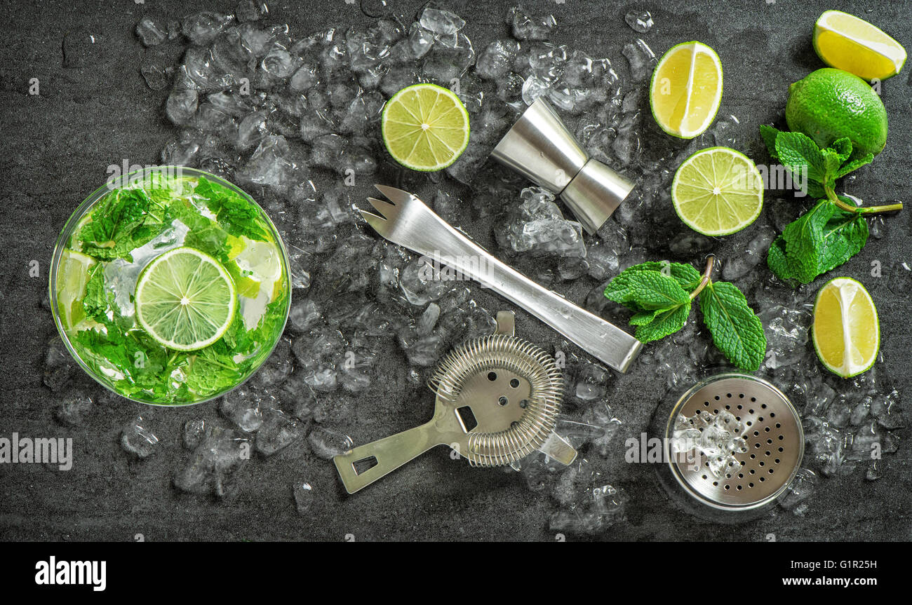 Cocktail drink making tools and ingredients. Cold drink. Mojito. Caipirinha. Vibrant colors - Stock Image
