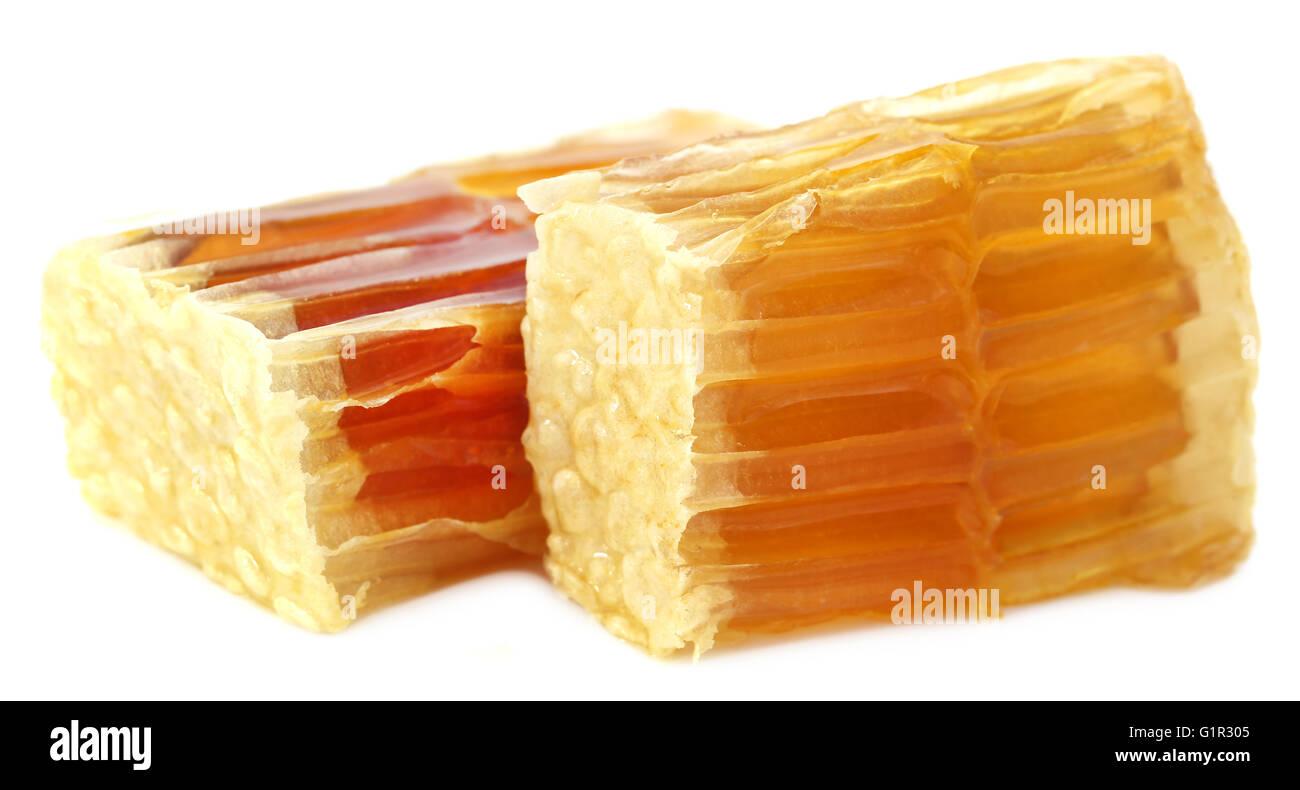 Honey comb over white background - Stock Image