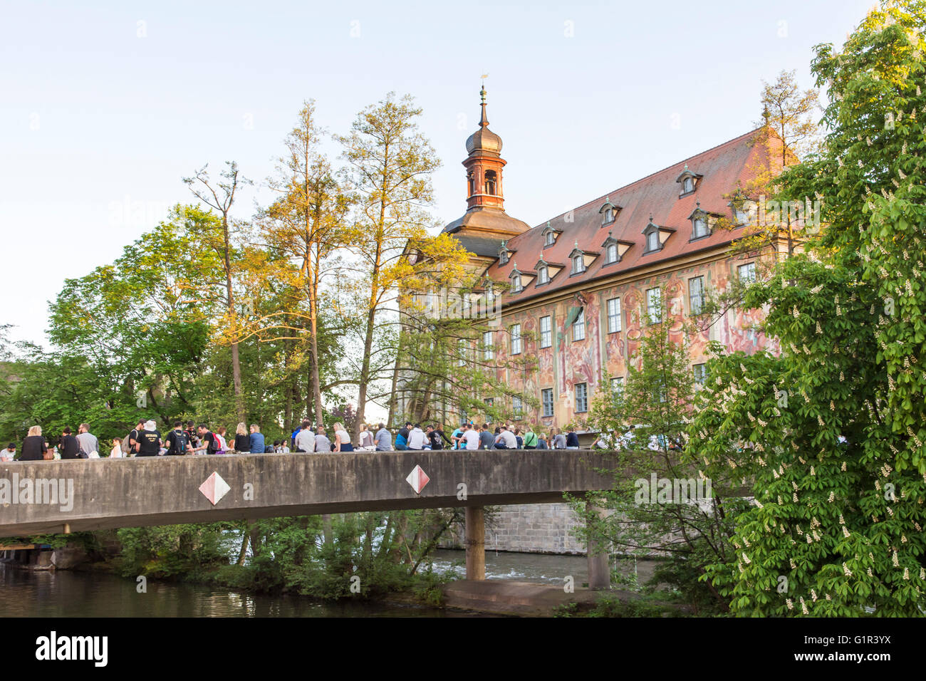 BAMBERG, GERMANY - MAI 7: Tourists at the historic town hall in Bamberg, Germany on Mai 7, 2016. - Stock Image