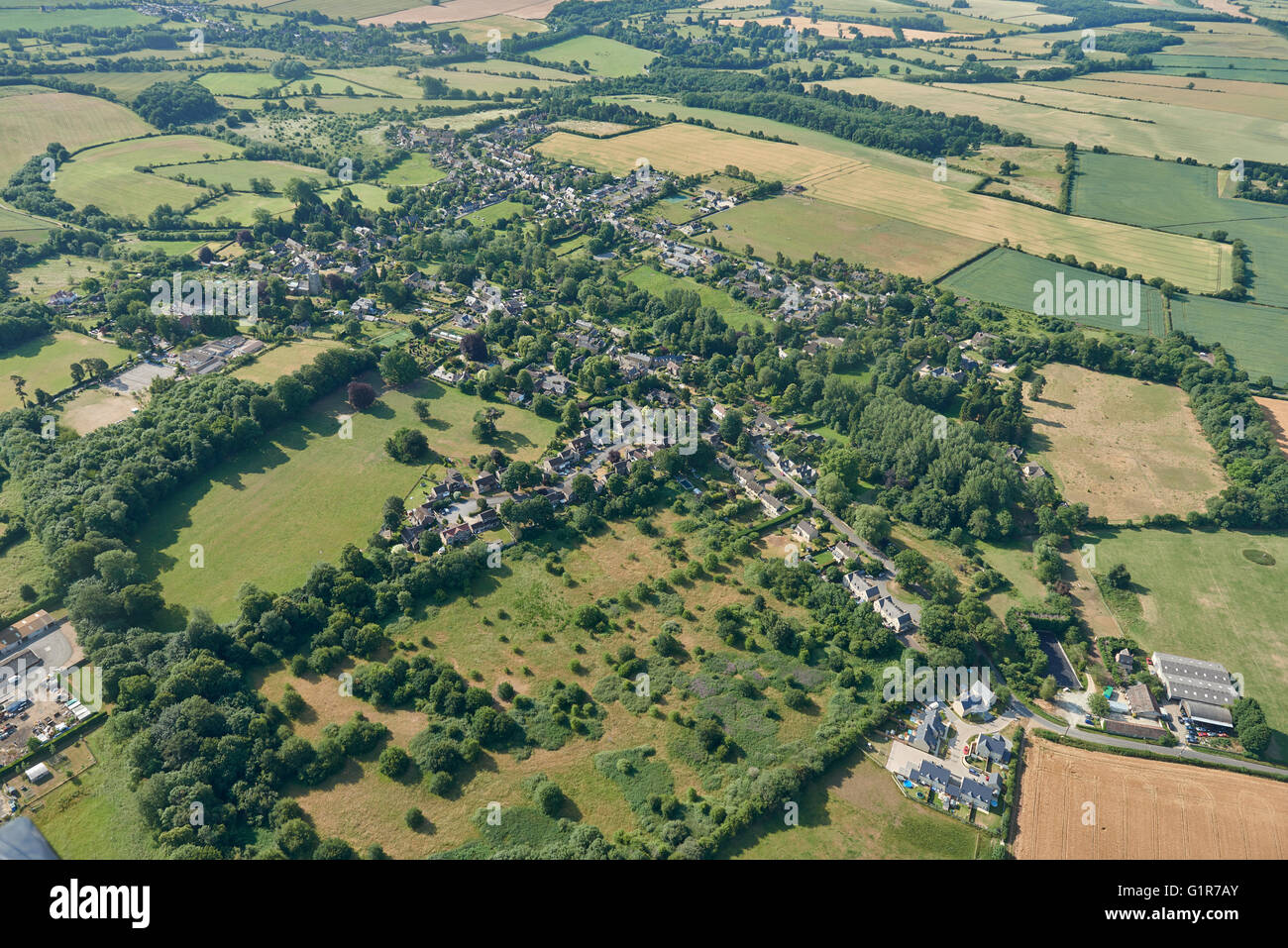 An aerial view of the village of Steeple Aston and surrounding Oxfordshire countryside - Stock Image