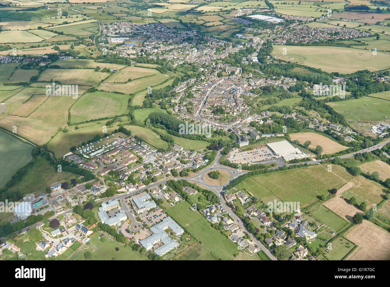 A wide aerial view showing the whole of the market town of Malmesbury in Wiltshire - Stock Image