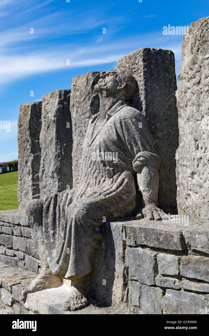 Memorial sculpture of George Loveless outside the Tolpuddle Martyrs Museum, Dorset in April - Stock Image