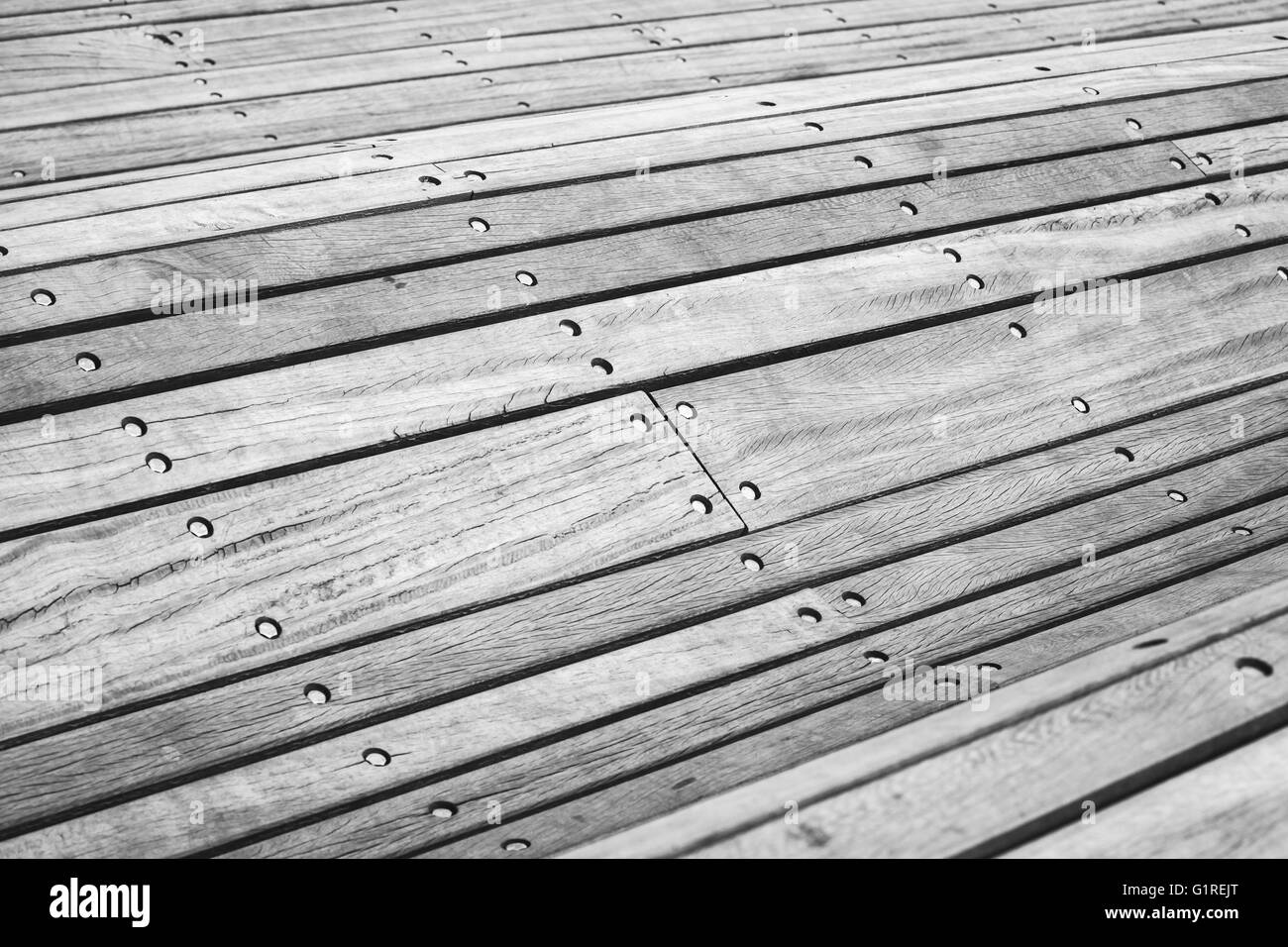 Abstract curved construction made of gray wooden planks, selective focus - Stock Image