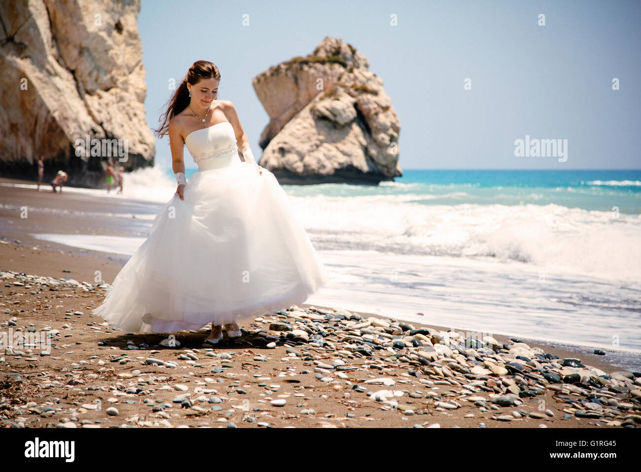 68bd7f9469 outdoor portrait of young beautiful woman bride in wedding dress on beach.  Petra tou Romiou - Aphrodite's Rock.