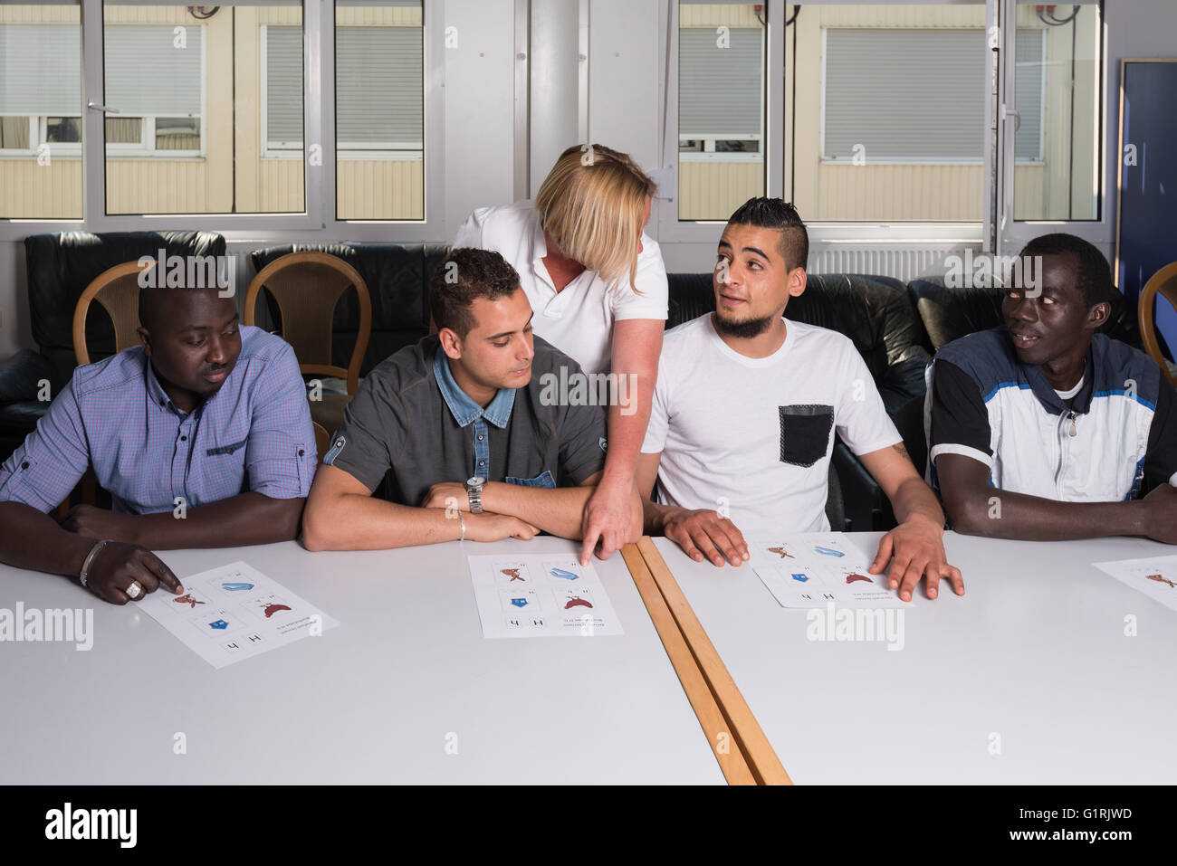 Language training for refugees in a German camp - Stock Image