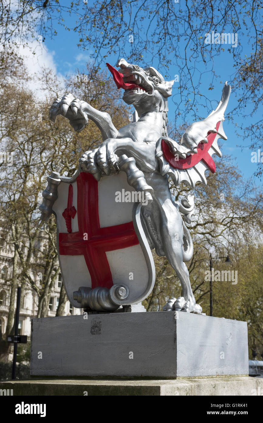 Dragon statue on Victoria Embankment marking the western boundary of the City of London UK - Stock Image