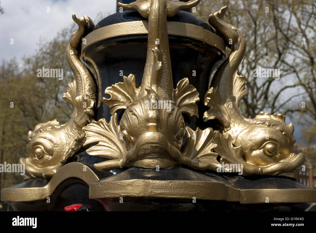 Golden fish detail on a street light on Victoria Embankment in London UK - Stock Image