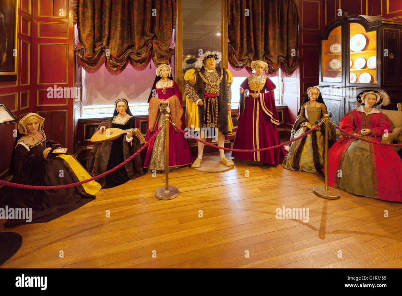 King Henry viii and his six wives, waxworks at Warwick Castle, Warwick, England UK - Stock Image
