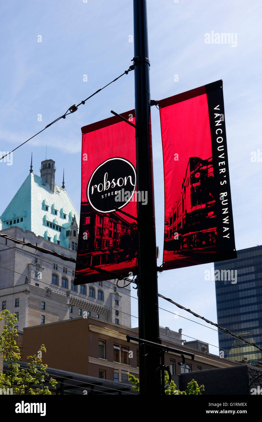 Banners hanging from a lamp post on Robson Street in downtown Vancouver, BC, Canada - Stock Image