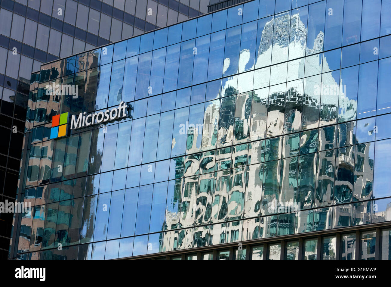 Buildings reflected in the Microsoft Canada Excellence Centre building facade in downtown Vancouver, British Columbia, - Stock Image