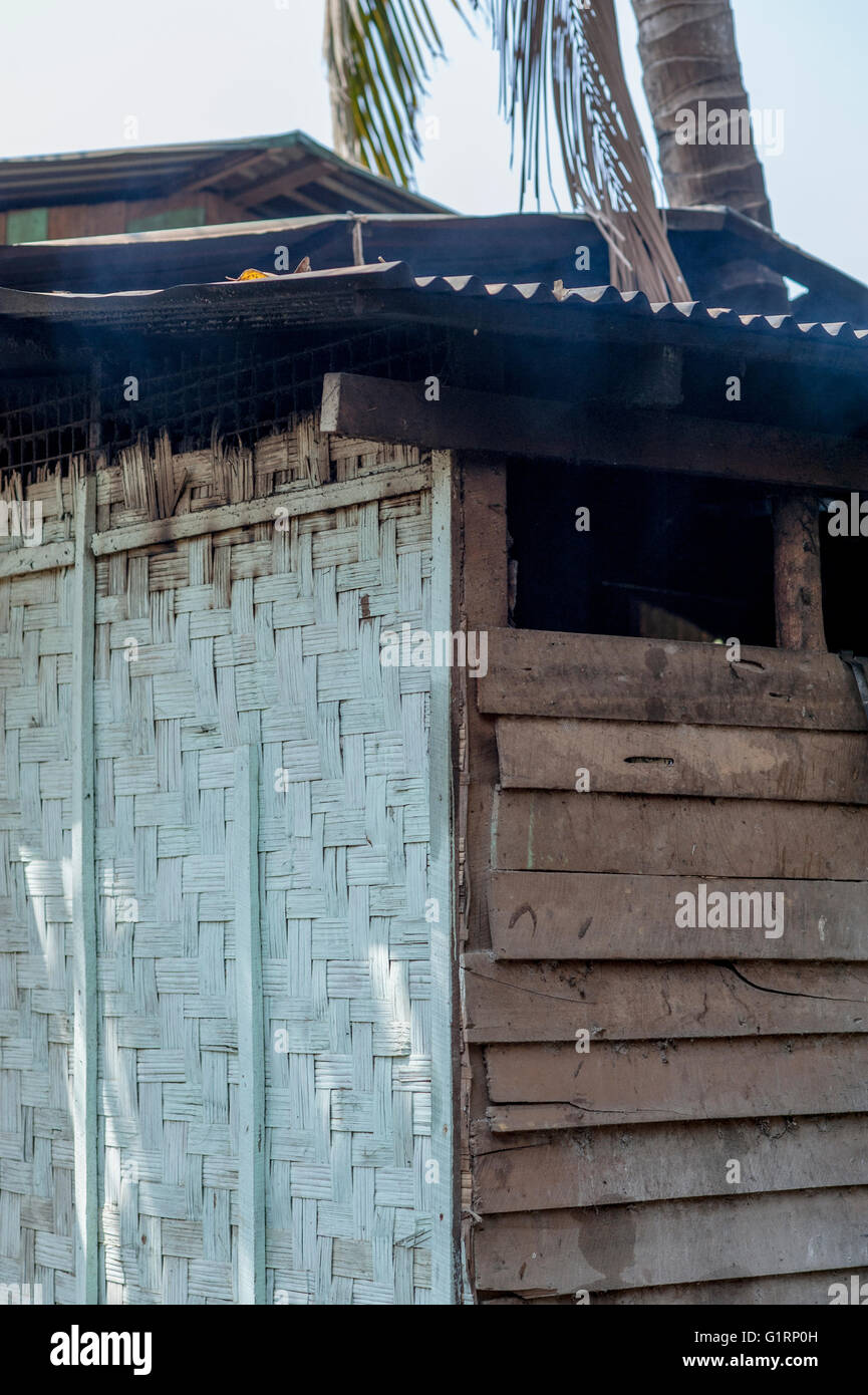 A wooden barrack on the streets of Kyaiktiyo in Myanmar, Asia. - Stock Image
