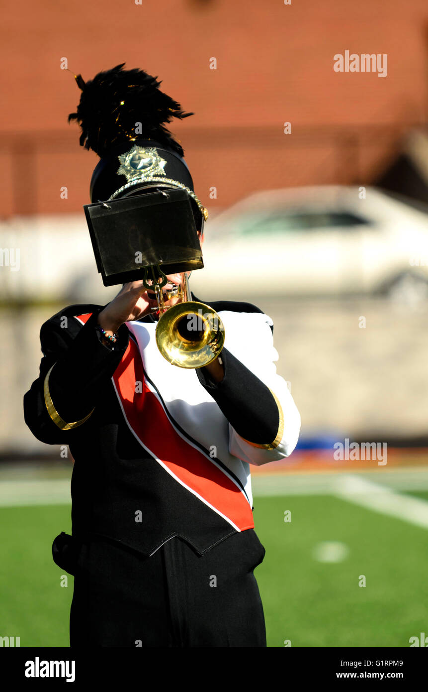 Marching band member playing trumpet - Stock Image