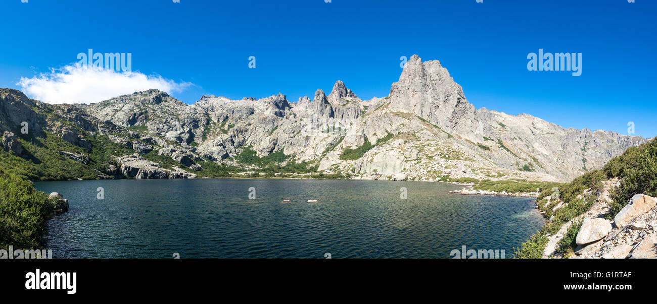 Mountain lake Lac de Melo, mountains in background, Restonica high valley, source of the Restonica River, Corte, - Stock Image