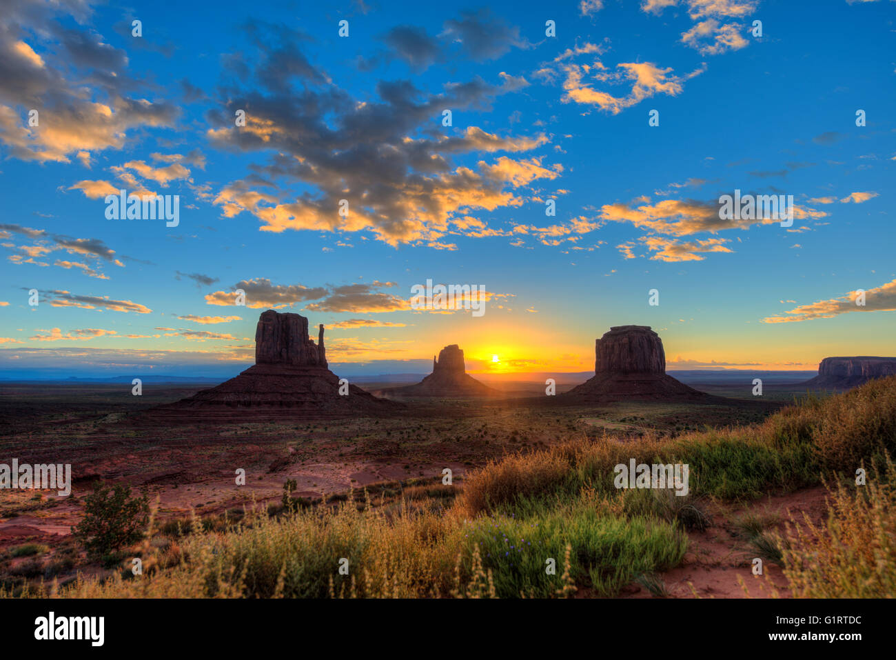 Sunrise, mesas West Mitten Butte, East Mitten Butte, Merrick Butte, Scenic Drive, Monument Valley, Monument Valley - Stock Image