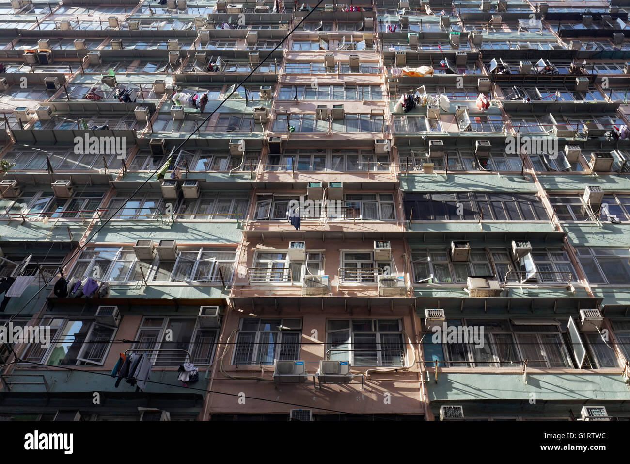 Old apartment block with cheap rented flats, Public Housing, Chun Yeung Street, North Point district, Hong Kong - Stock Image
