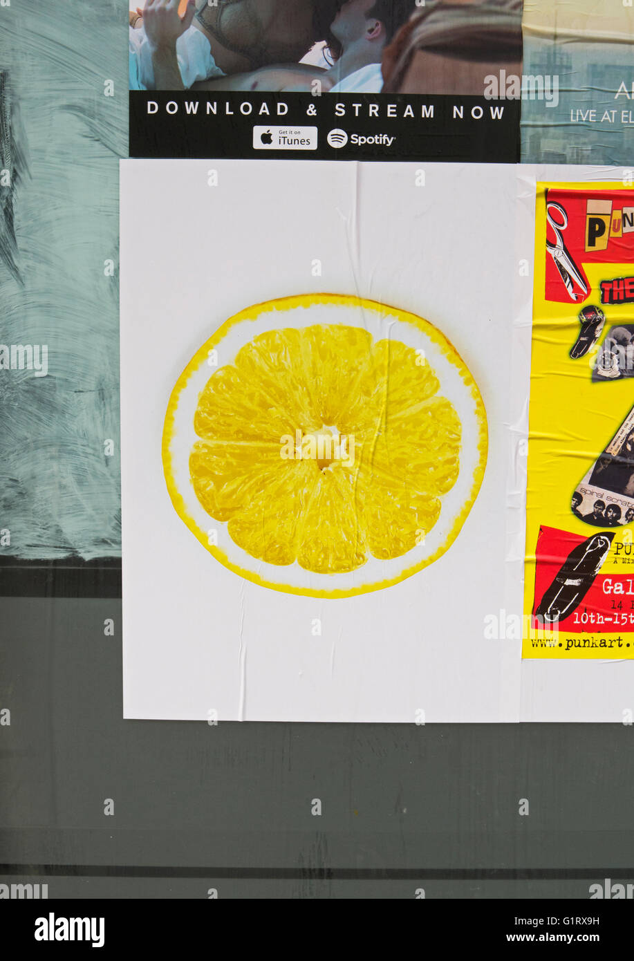 The cryptic lemon slice poster announcing the release of a new song by the Stone Roses. - Stock Image