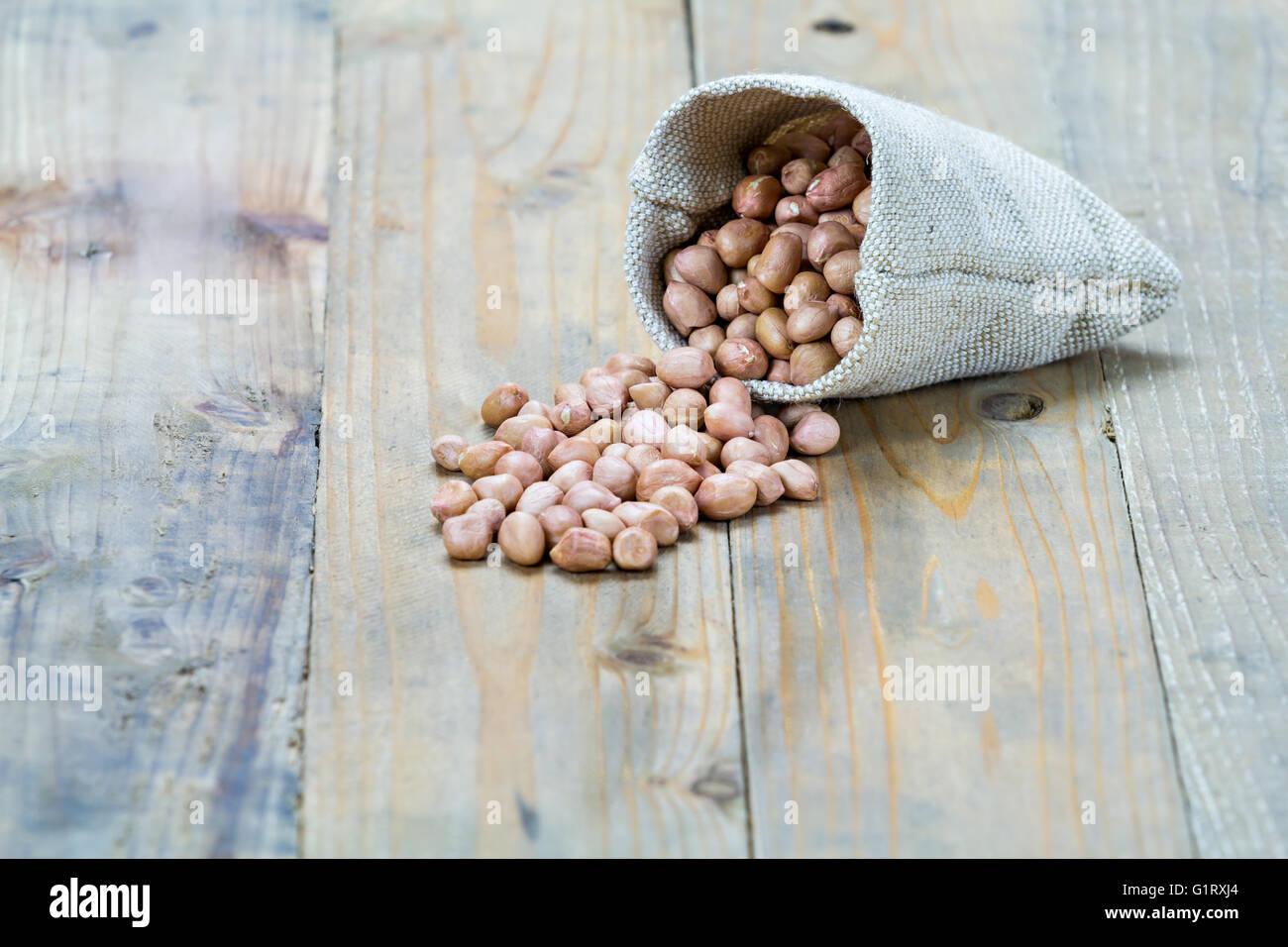 peanut on vintage wooden boards still life - Stock Image