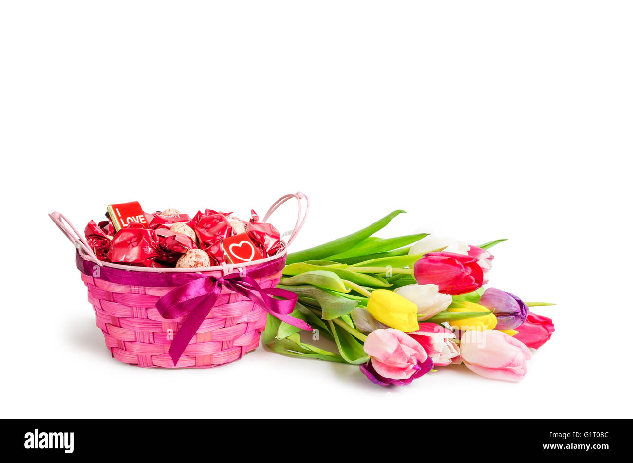Basket Of Candies And Bouquet Of Tulips Tied With A Ribbon Isolated