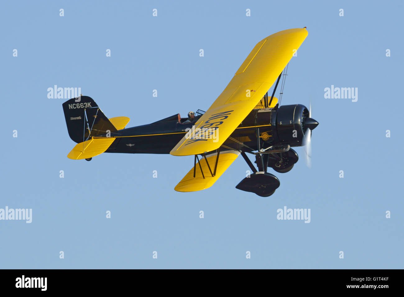 Airplane vintage WWII bi-plane propeller aircraft flying at 2016 Planes of Fame Air Show in California - Stock Image