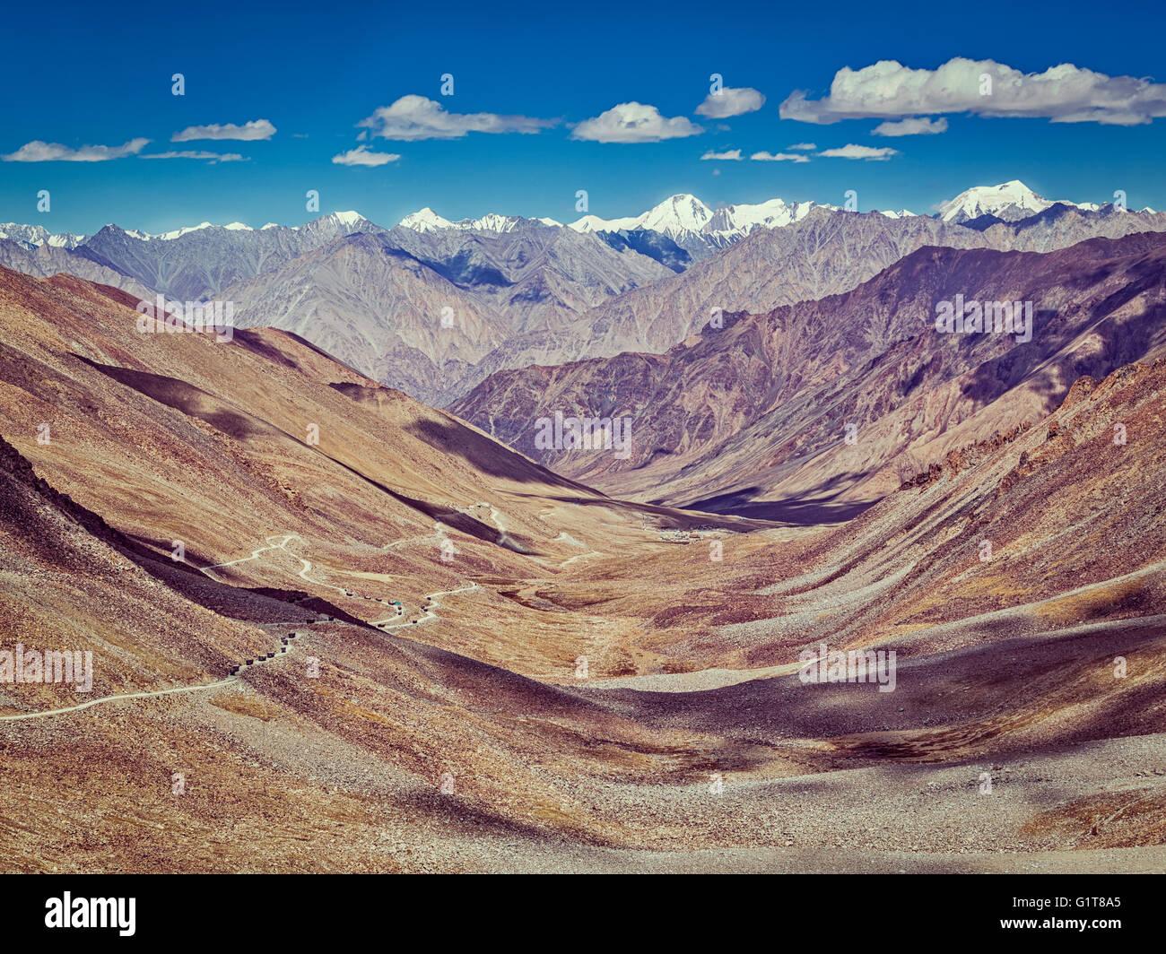 Karakoram Range and road in valley, Ladakh, India - Stock Image