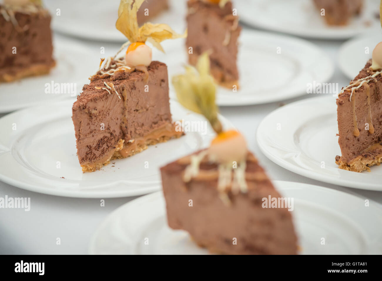 A collection of chef prepared chocolate desserts placed on a table, landscape format aspect ratio. - Stock Image