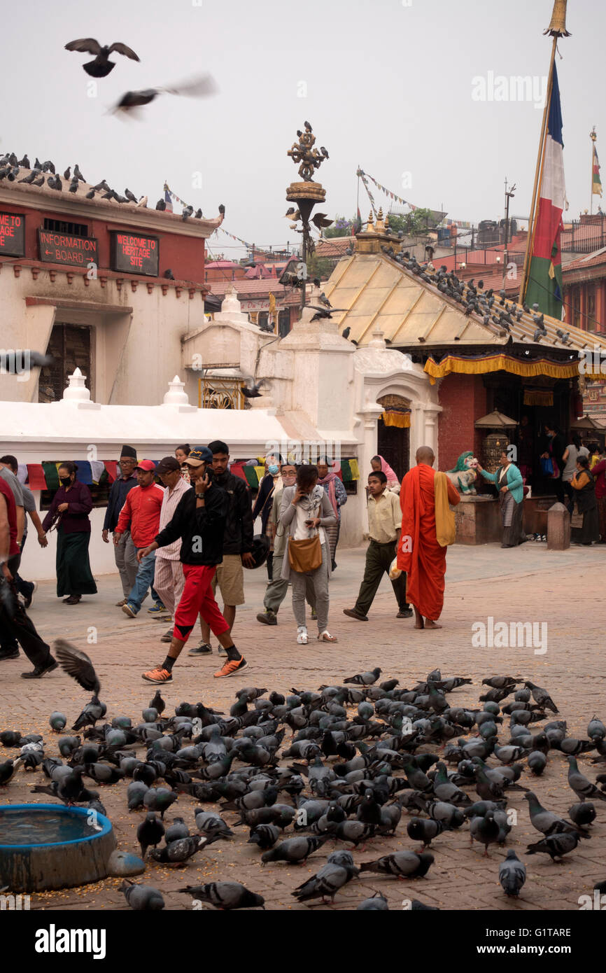 Devoted buddhists at Boudhanath Stupa, a temple in Kathmandu, Nepal - Stock Image