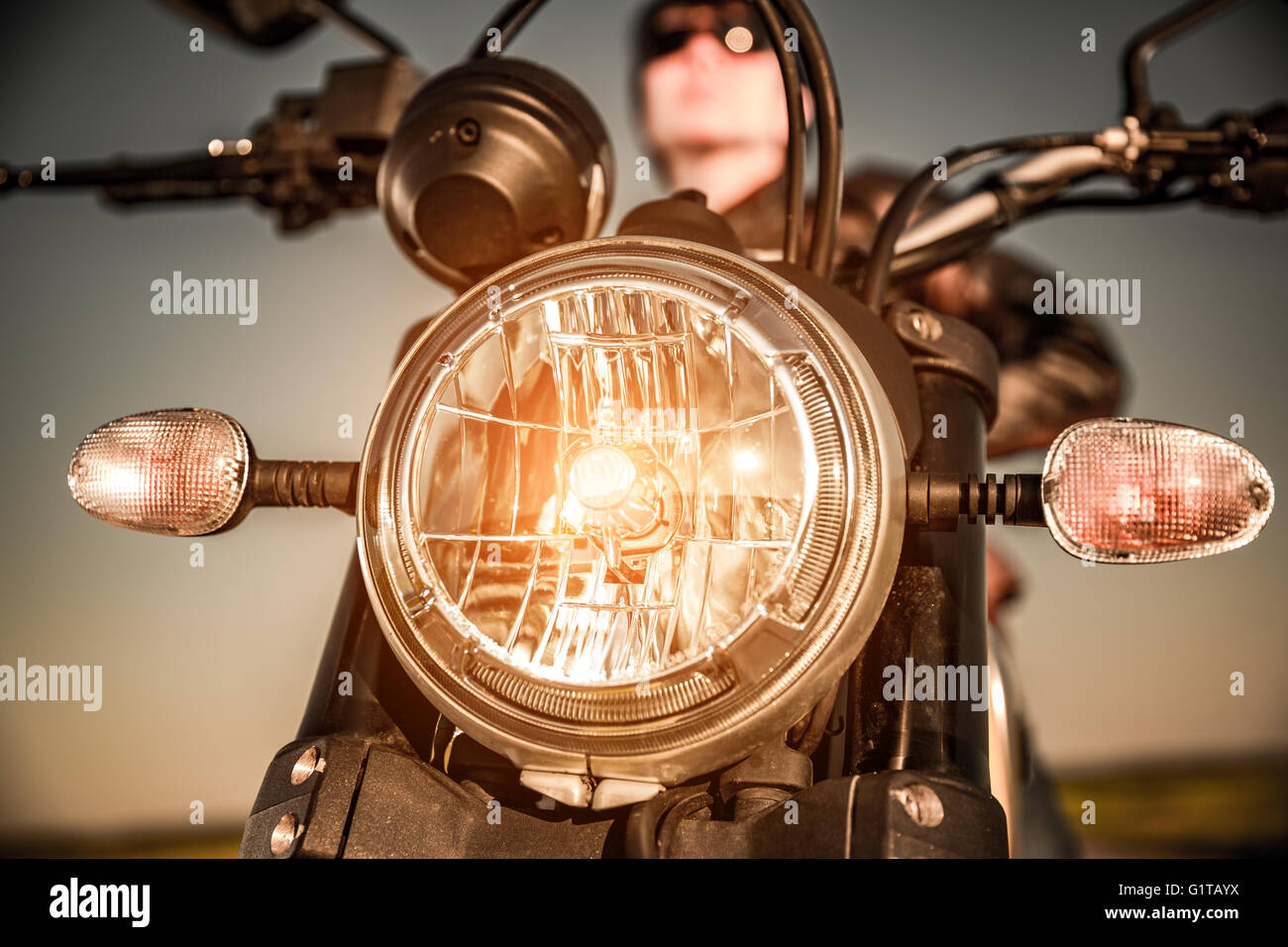 Motorcycle on the road motorcycle headlamp closeup - Stock Image