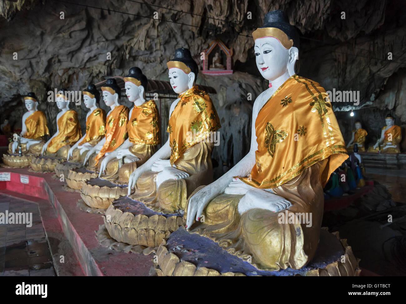 Buddha statues, Bayint Nyi (Bayin Gyi Gu or Begyinni) cave temple and hot springs, Mon State, Burma (Myanmar) Stock Photo