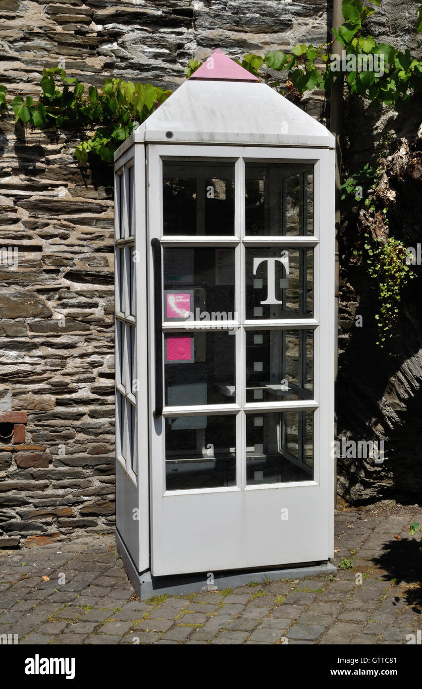 A public telephone box in Beilstein, on the Moselle River, Germany. - Stock Image
