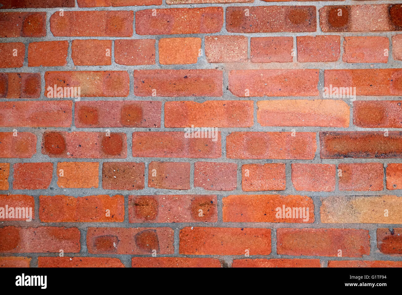 Red brick wall for use as a design texture or background. May 2016 - Stock Image