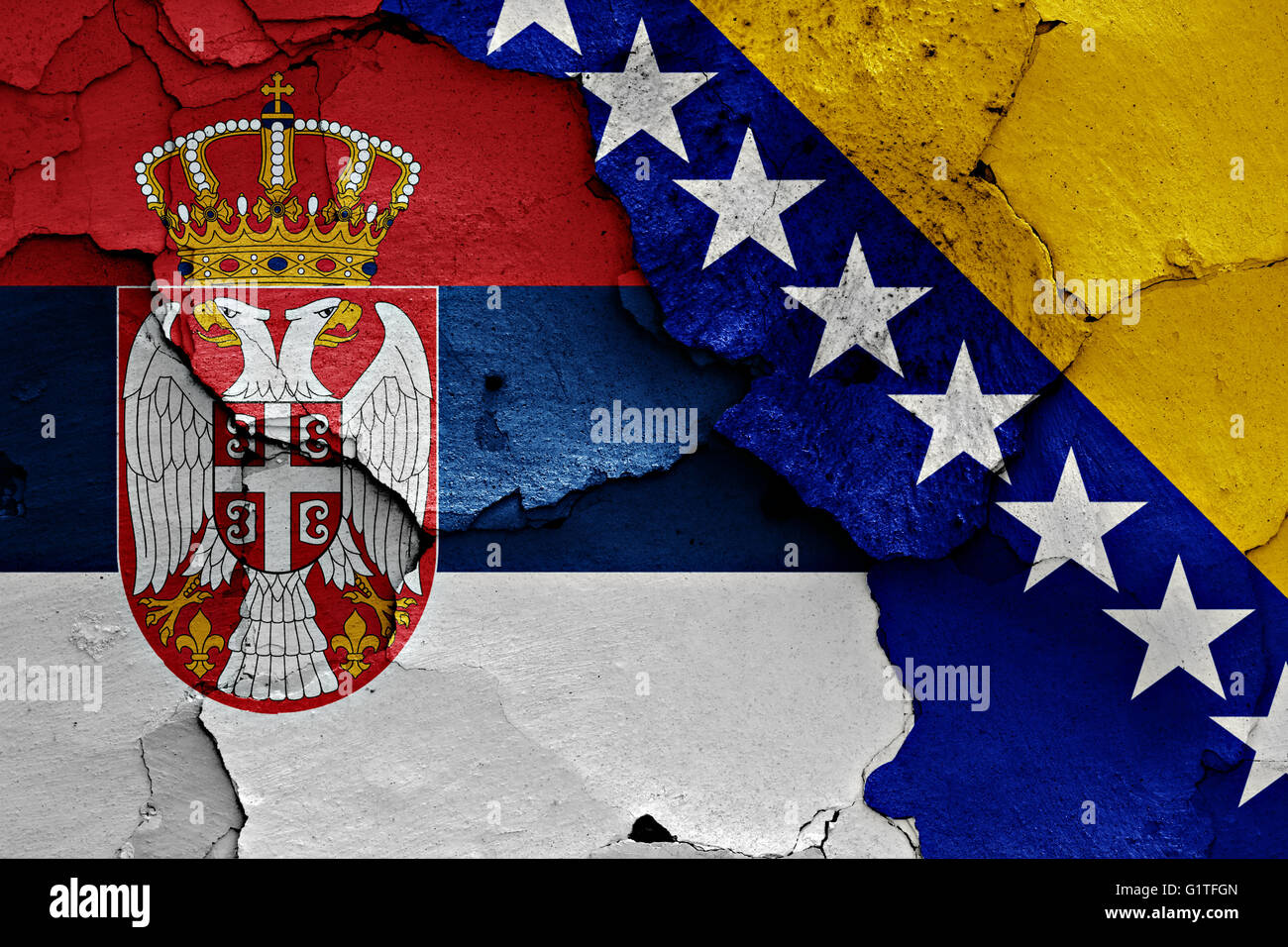 flags of Serbia and Bosnia and Herzegovina painted on cracked wall - Stock Image