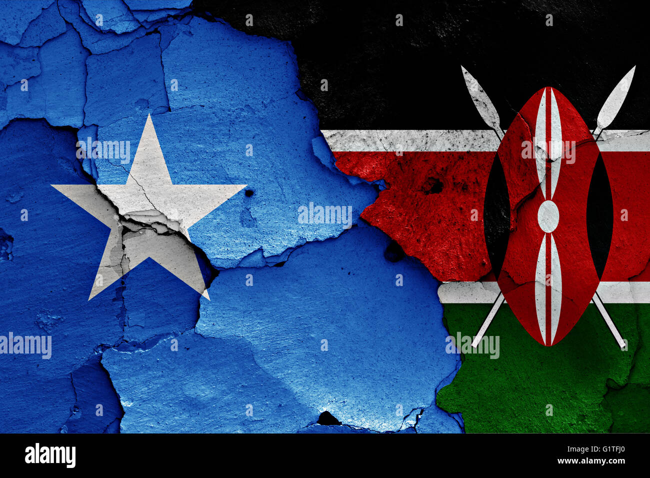 flags of Somalia and Kenya painted on cracked wall - Stock Image