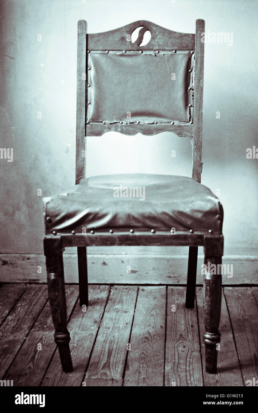 Black And White Photograph Of An Old Rickety Victorian Style Chair On  Wooden Floorboards, Shot On Film