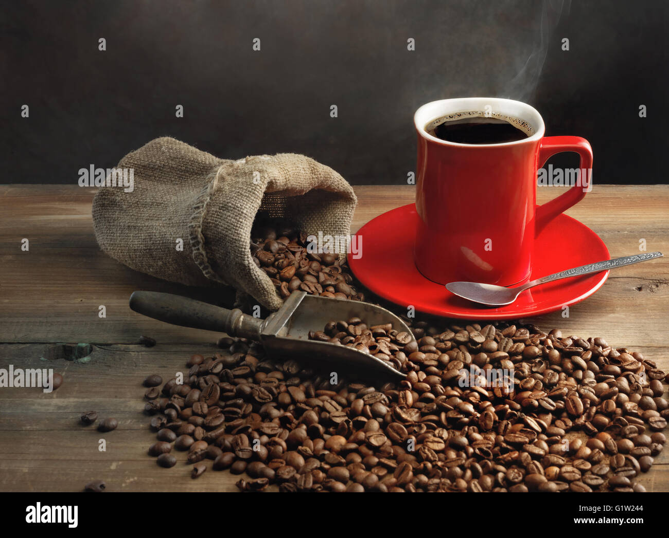 Coffee cup and coffee beans on wooden table - Stock Image