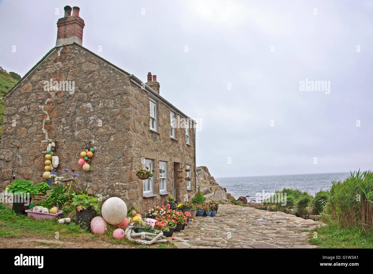 A Traditional Stone Fishing Cottage Overlooking The Sea At Penberth Cove  near Penzance in Cornwall - Stock Image