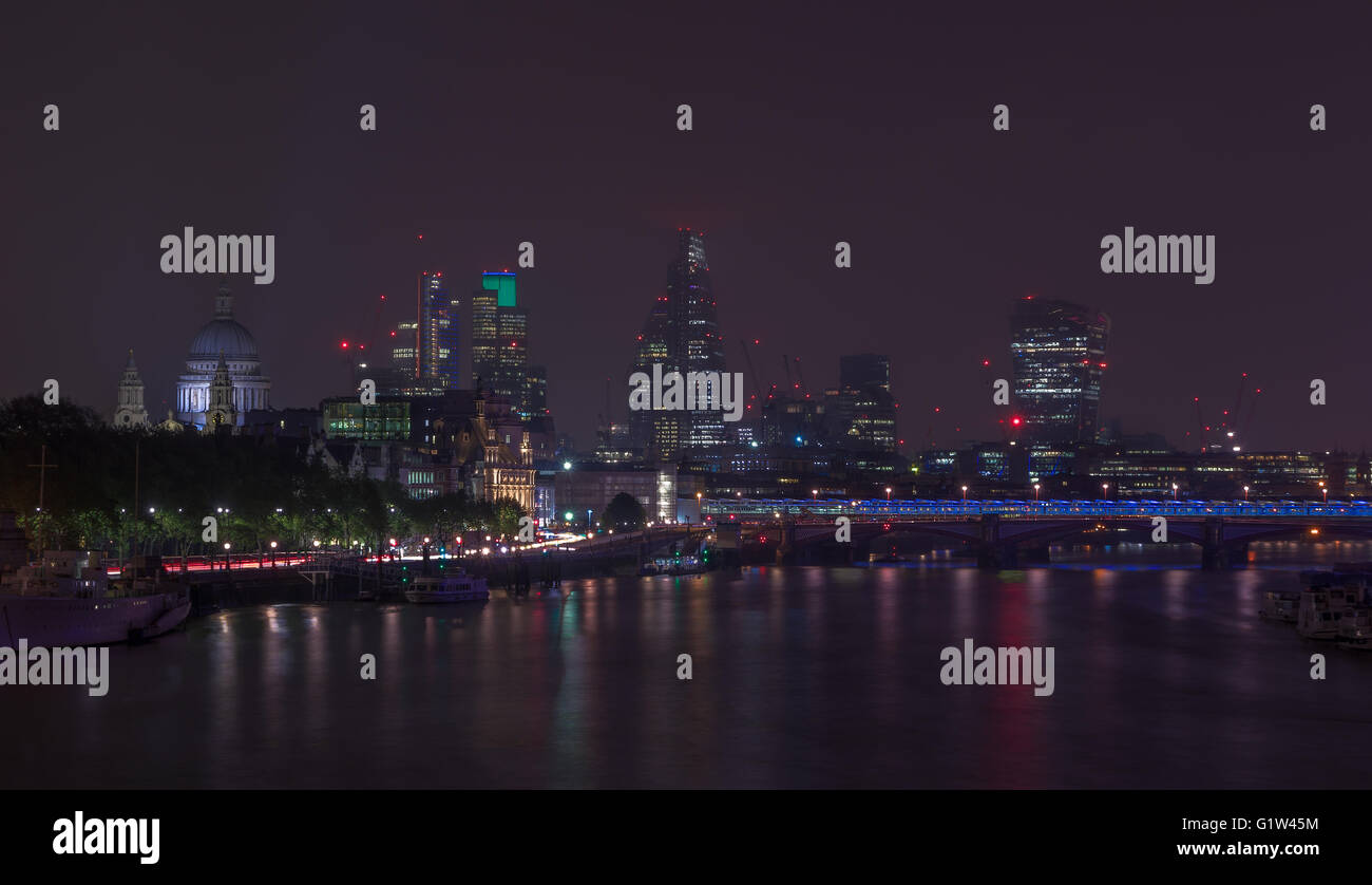 London cityscape at night including St, Paul's Cathedral and Blackfriars Bridge - Stock Image