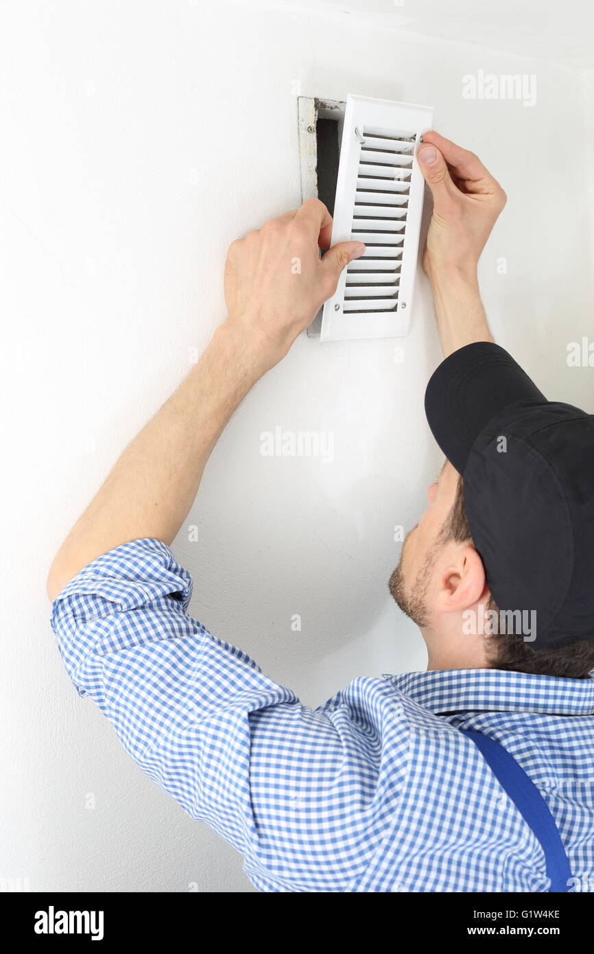 A Craftsmen changing a Ventilation filter 2 - Stock Image