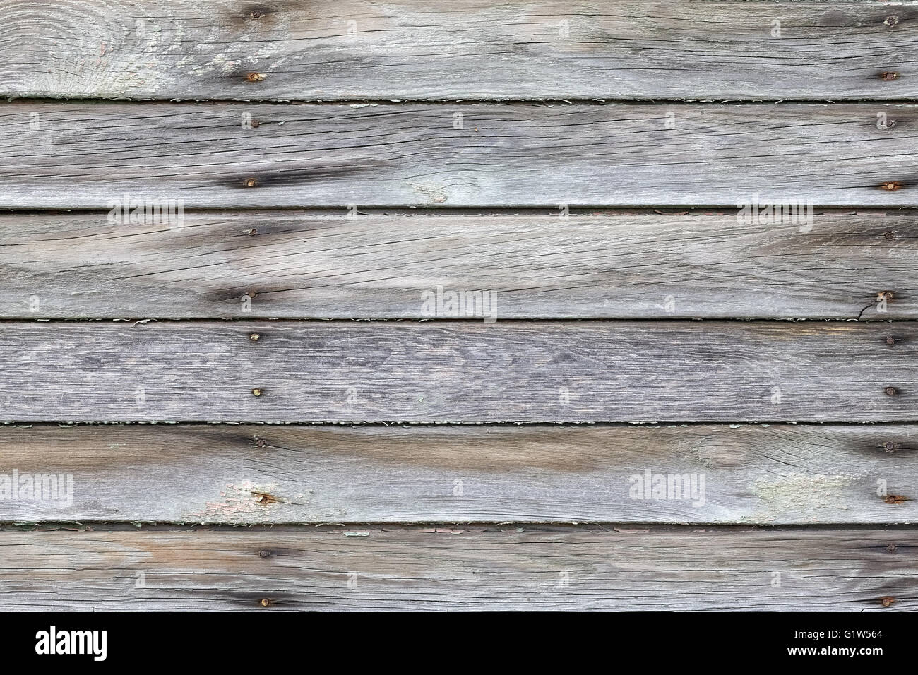 Old weathered wooden boards with rusty nails. - Stock Image