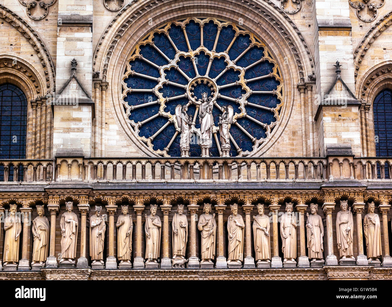 Kings Facade Rose Window Notre Dame Cathedral Paris France.  Notre Dame was built between 1163 and 1250 AD. - Stock Image