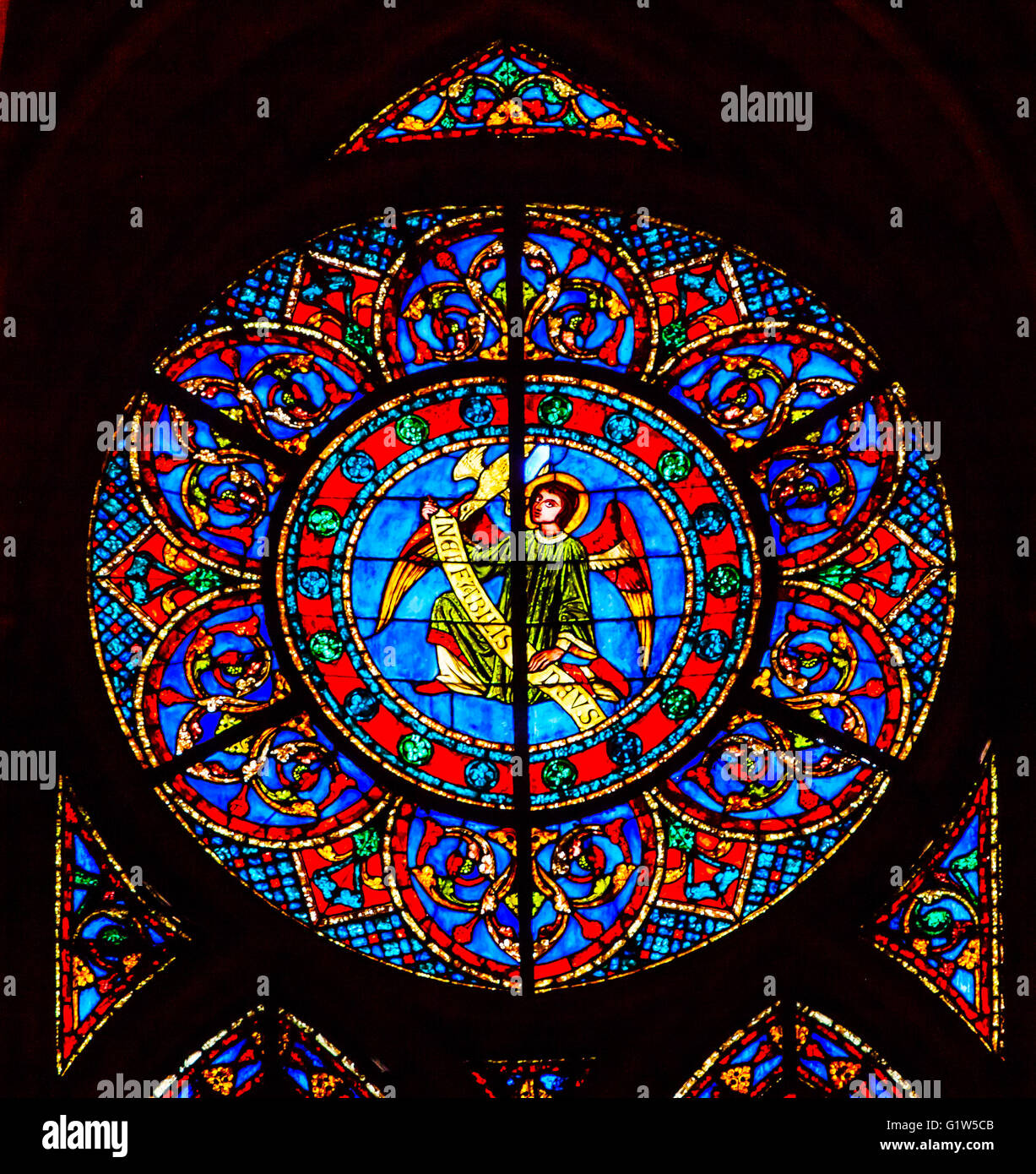 Angel Stained Glass Notre Dame Cathedral Paris France.  Notre Dame was built between 1163 and 1250 AD. - Stock Image