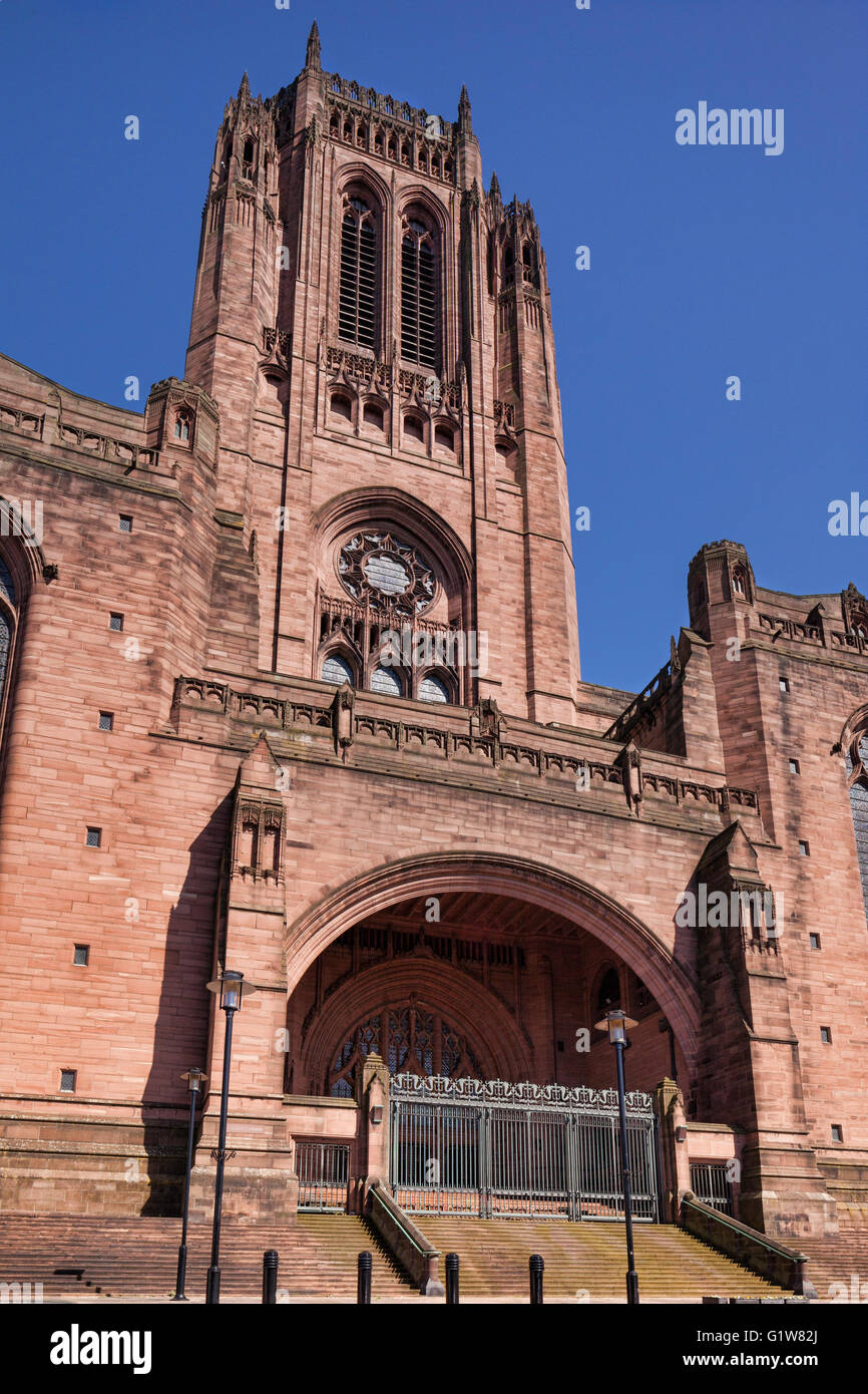 The west door and tower of the Anglican Cathedral in Liverpool, Merseyside, England. - Stock Image