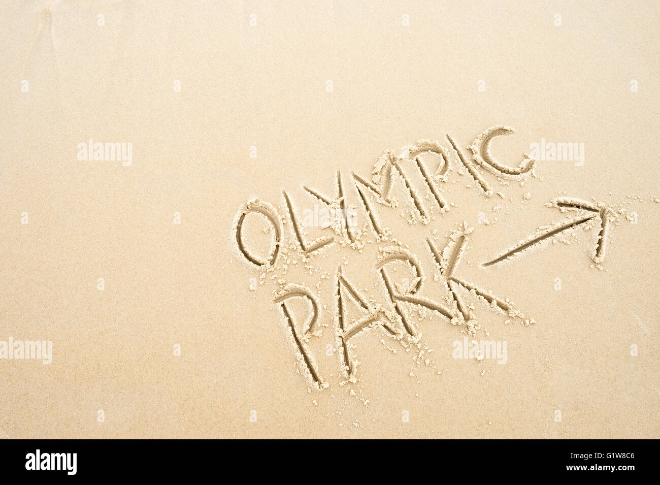 RIO DE JANEIRO - NOVEMBER 10, 2015: Handwritten message with arrow pointing the way to Olympic Park written in smooth - Stock Image