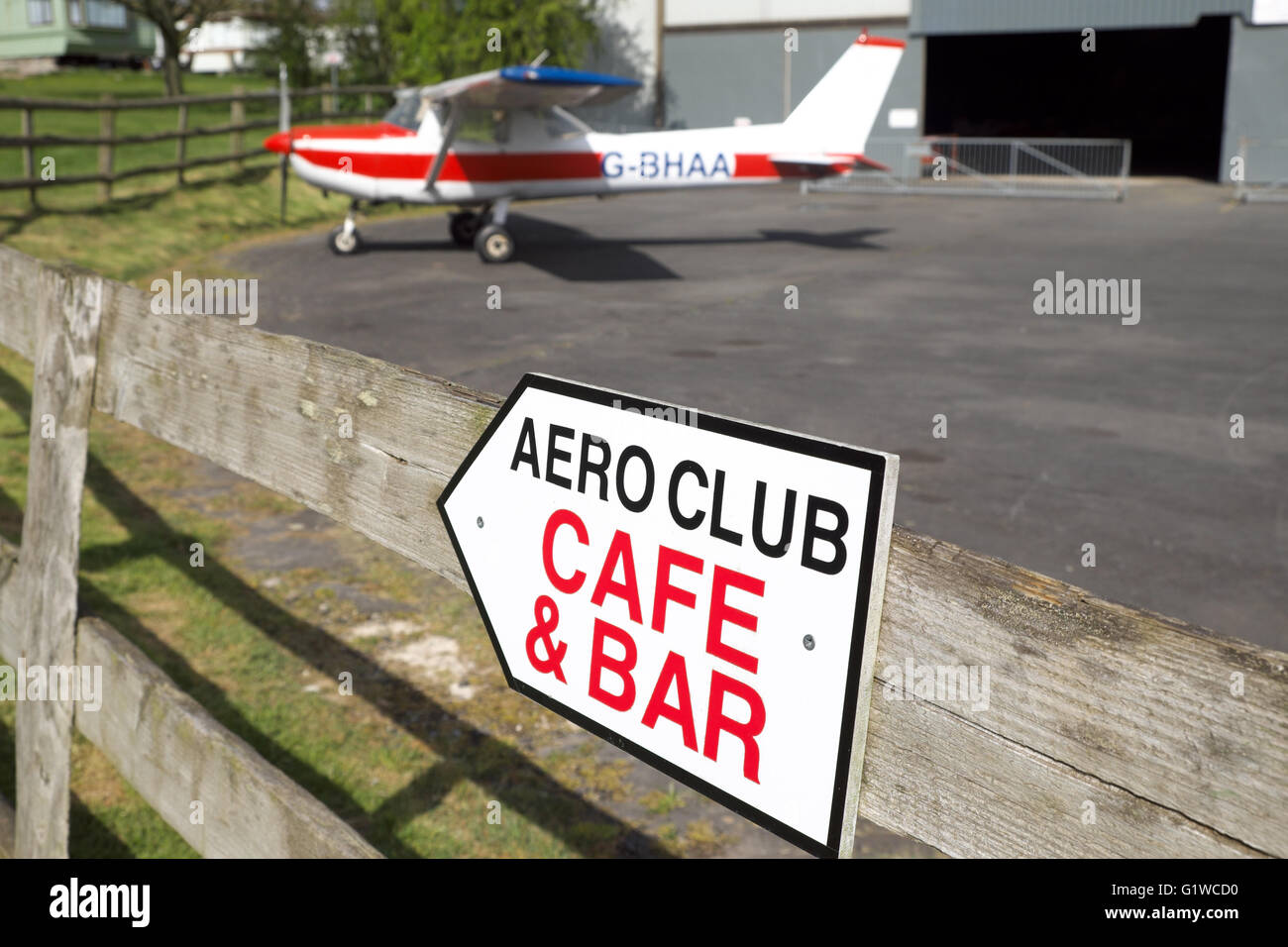 Shobdon airfield Herefordshire sign to Aero Club cafe and bar with a Cessna 152 aircraft - Stock Image
