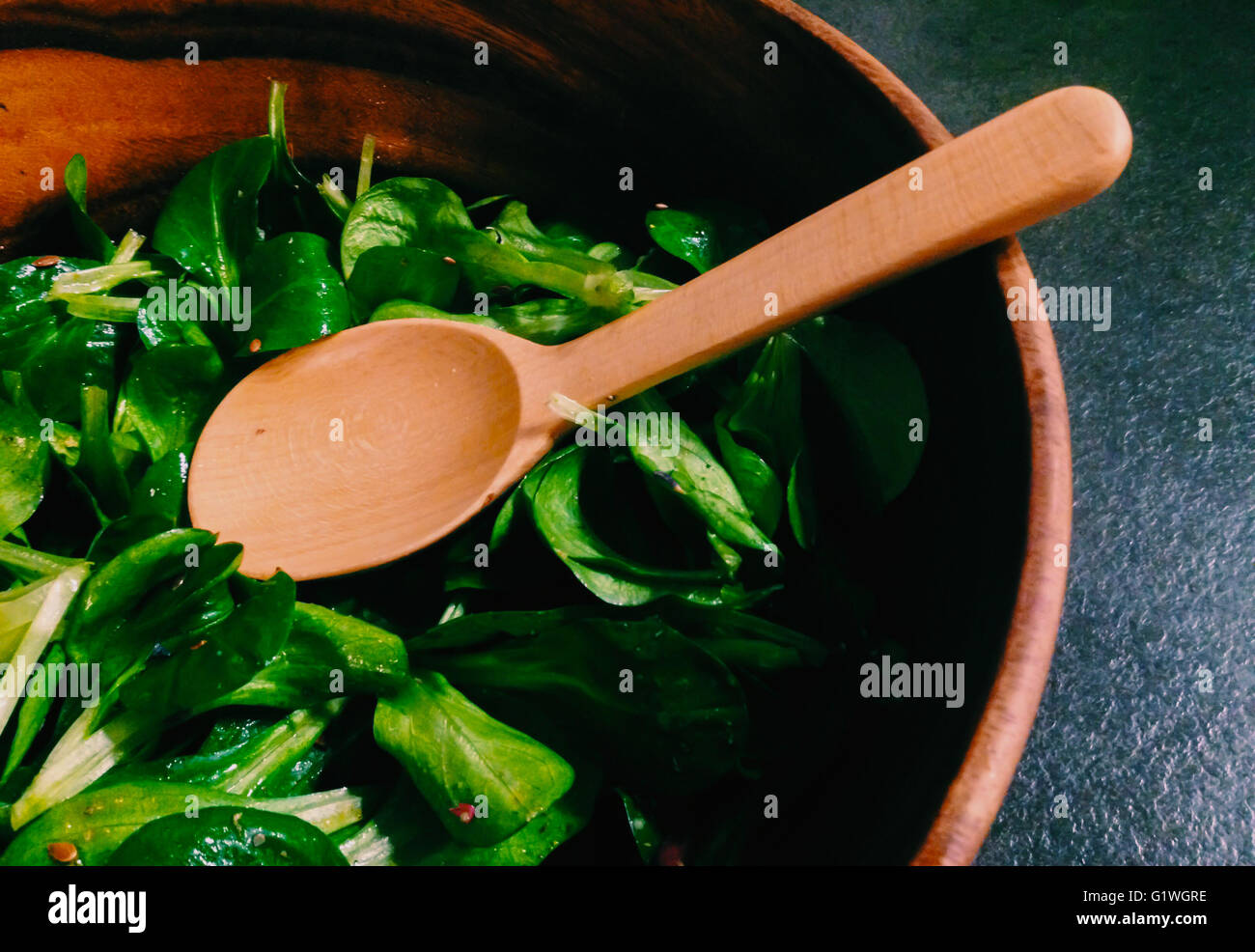 Salad in a woody bowl - Stock Image
