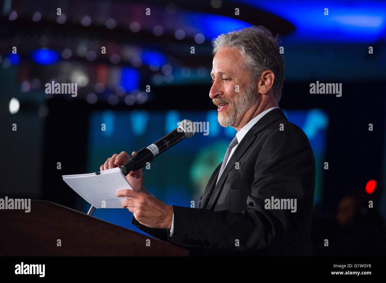 Comedian Jon Stewart gives a monologue during the 75th anniversary celebration of the USO April 19, 2016 in Washington, - Stock Image